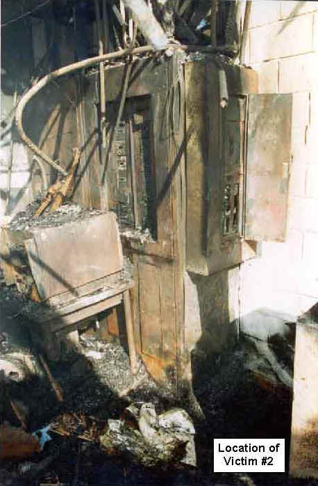Photo 13: Post-fire, interior view of the restaurant, showing the location of Victim #2.