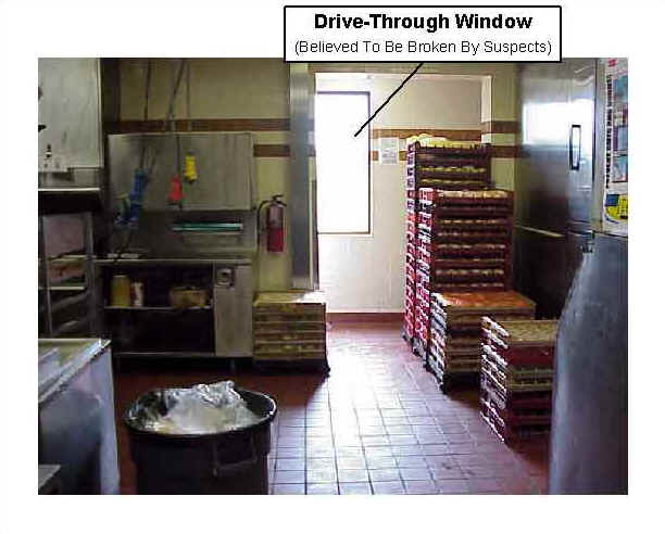 Photo 4: Pre-fire, interior view of similar drive-through window of the restaurant.