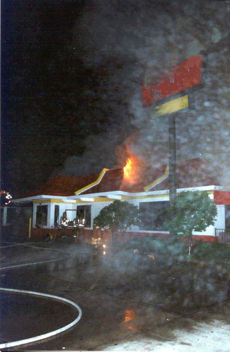 Photo 5: Exterior view of the restaurant during the early stages of the fire.