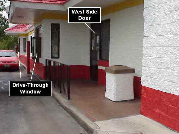 Photo 7: Pre-fire, exterior view of the west side of similar restaurant, showing the drive-through window and west side door.