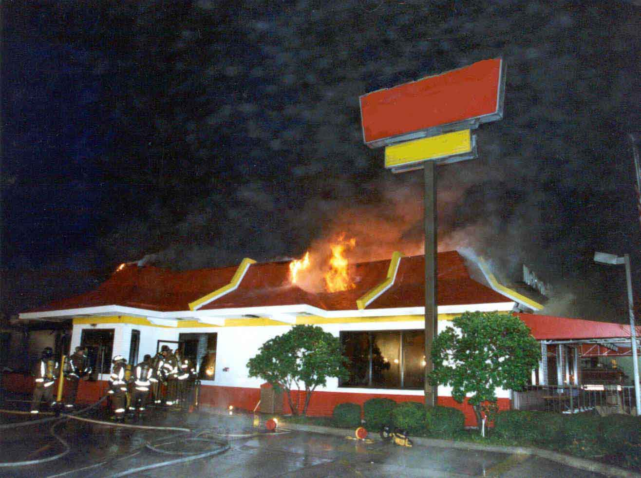 Photo 9: Exterior view of the restaurant fire at the approximate time the roof collapsed.