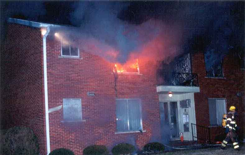 front page photo: Photograph of burning apartment building involved in this incident.