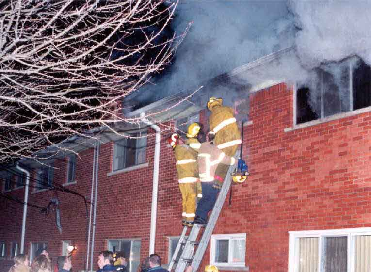 Photo 3.  Photograph of Fire Fighter #1 being removed from the bathroom window.