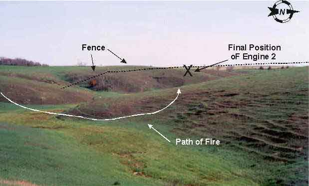 Diagram 1. Incident site, indicating approximate locations of fence line, final position of Engine 2, and path of fire.