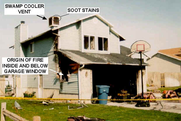 Photo 2: Photo showing the front and south end of the house taken from the street.