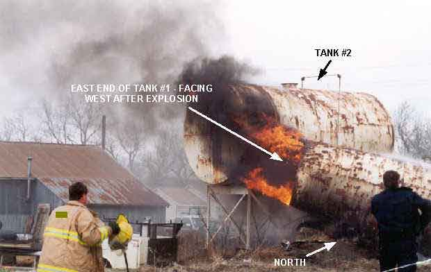Photo 4: Photograph of Tank #1 immediately after explosion occurred, showing the final resting position of the east end of the tank.