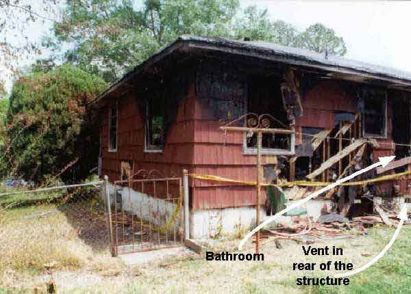Photograph of the rear of the structure, depicting the location of the bathroom and the rear vent.