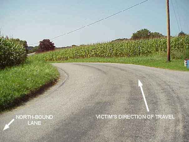 Photograph showing the curve in the road that the victim was traveling.
