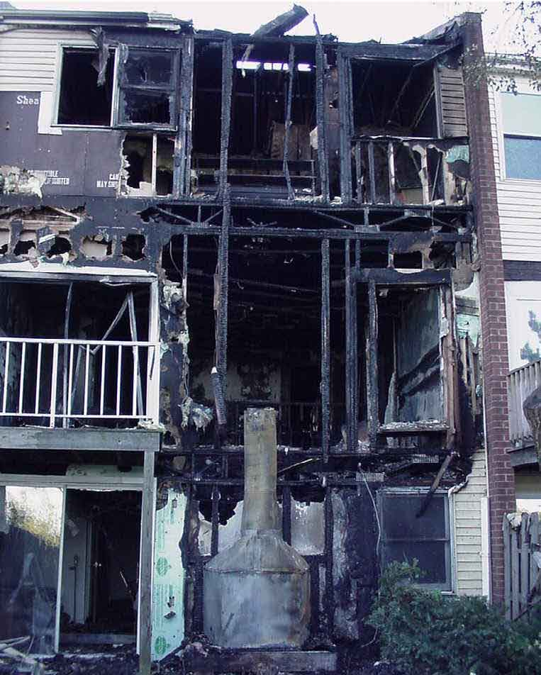 front page photo: Photograph of the burned-out townhouse involved in this incident.