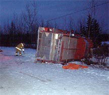 Photograph of the overturned fire engine.