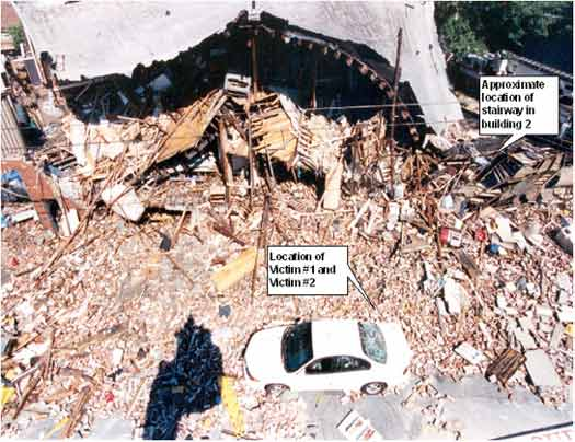 Photo 1. Collapse of Building from Side 2