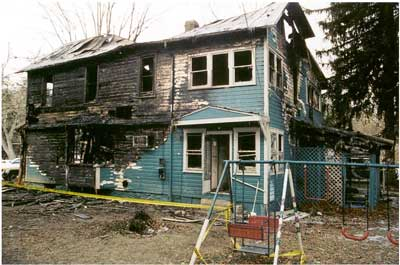 Photo 2. Rear of incident structure