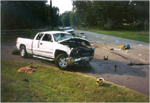Photo 3. Illustrates damage to the passenger's side of the vehicle.