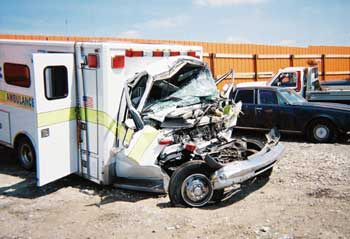 Photo 3. Front cab of ambulance after collision