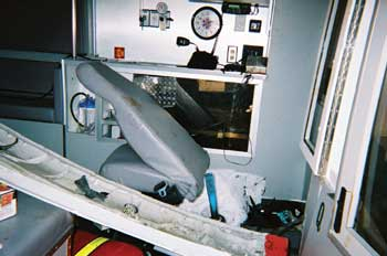 Photo 4. Attendant's seat after crash; note intrusion of drive shaft into compartment