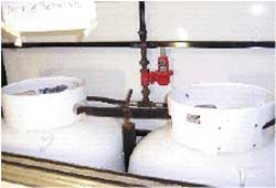 Photo 3. LPG cylinders in equipment room at front of trailer.