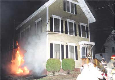 Photo 2. B-side basement windows engulfed in flames.