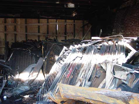 Photo 1. Interior of structure showing contents after fire suppression