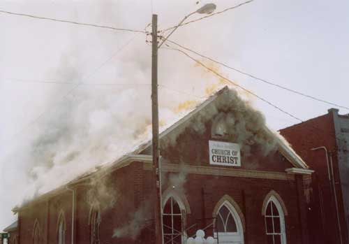 Photo 1. Church fire showing before collapse of roof and facade.