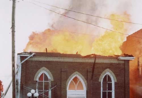 Photo 2. Church fire showing after collapse of roof and facade.