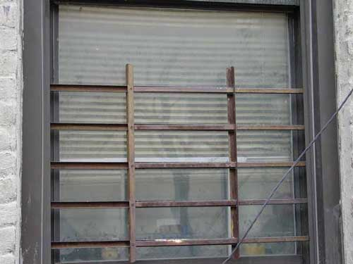 Photo 3. Child Guard Gate on Apartment Windows