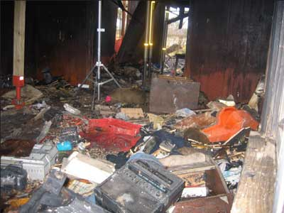 Photo 1. Note cluttered condition of floor in living room.