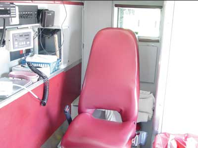 Photo 2. Photo from similar ambulance illustrating the attendant's seat configuration prior to crash.