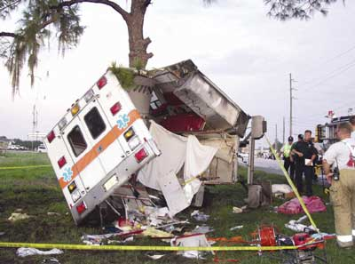 Photo 3. Patient compartment of ambulance after crash, showing the separation of curbside wall and roof.