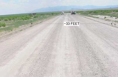 Photo 1. Incident Site, showing dirt road, indicating width.