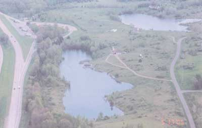 Ariel view of incident site showing lake at quarry.