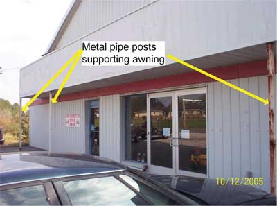 A-side of structure taken four months prior to incident. Note overhanging awning over entranceway; metal pipe posts supporting front of awning.