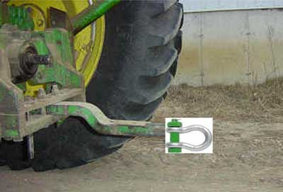 Photo 4. Shackle attached to draw bar on larger tractor (representation only).