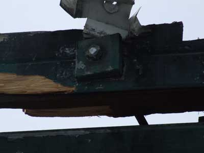 Failed metal support rods bolted to roof rafter
