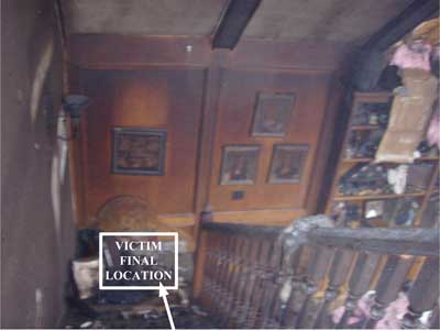 arrow pointing to bottom of stairwell indicating the final location of victim