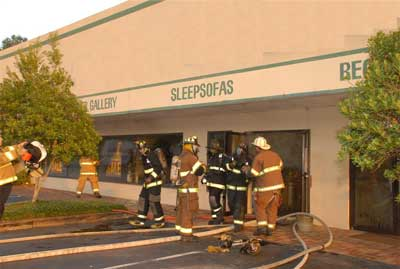 Fire fighters exiting showroom