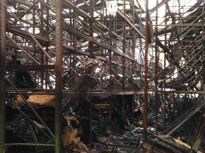 Tall storage racks inside the warehouse after the fire.