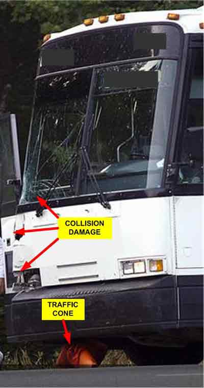 collision damage on bus and traffic cone under bus