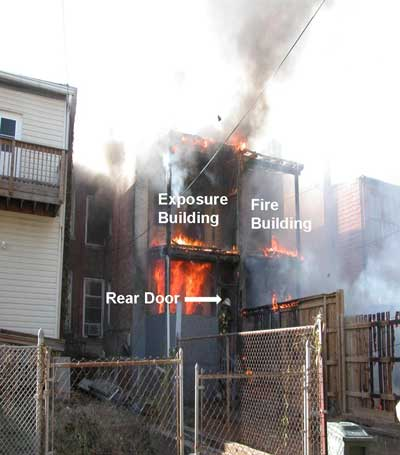 arrow pointing to rear door of burning structure