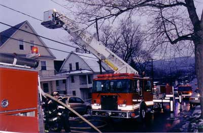 Fire truck with elevating platform near powerlines