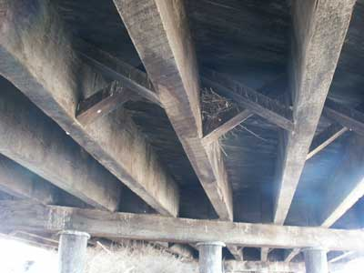 Wooden beams underneath the timber bridge
