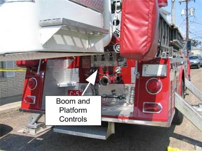 rear of aerial fire truck with platform controls