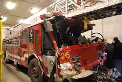 heavy damage to the cab of a fire truck