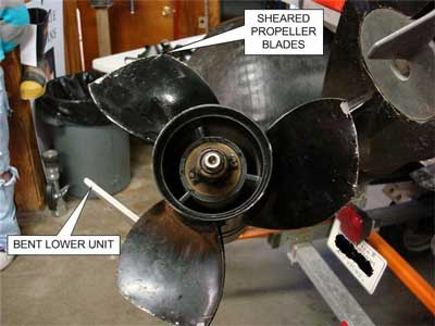 Sheared Propeller  Blades and bent lower unit.