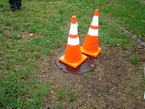safety cones on manhole cover