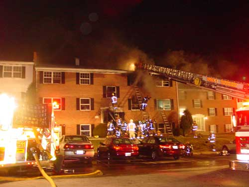 fire fighter dropping from 3rd floor window