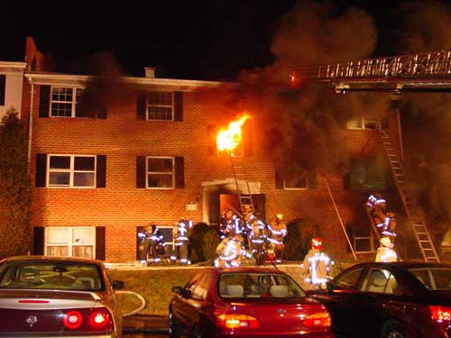 fire fighters and burning building