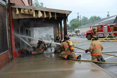 fire fighters operating hose lines
