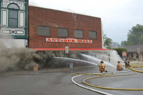 3 hoses lines attacking the fire