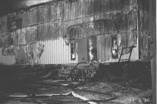 Front door of the burning structure where both victims entered to perform an interior fire attack