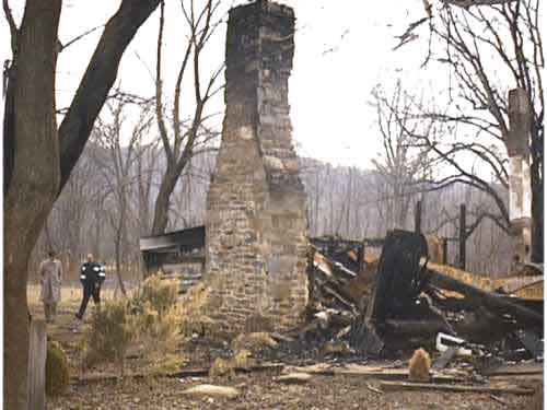 Log cabin where fire occurred.